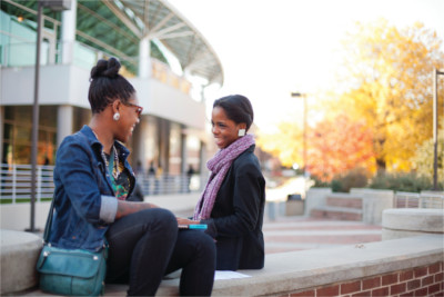 Two NCAT students sitting on a bench